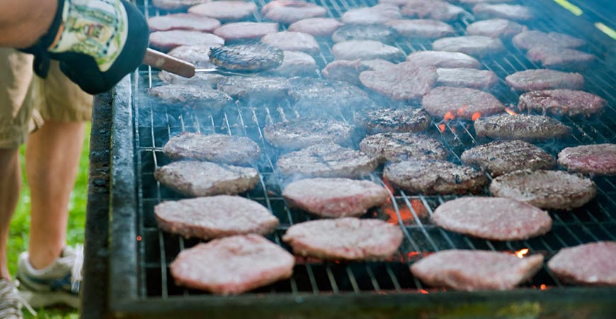 cooking burgers on grill