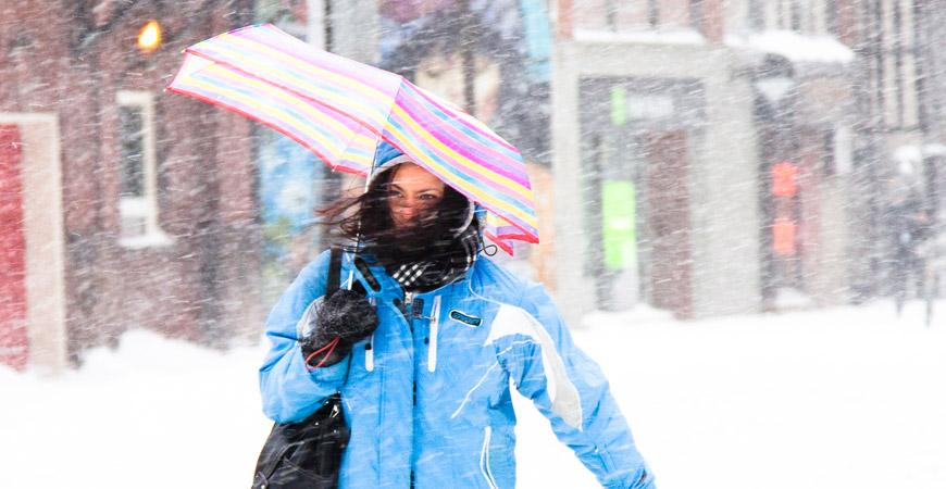 woman walking in snow storm