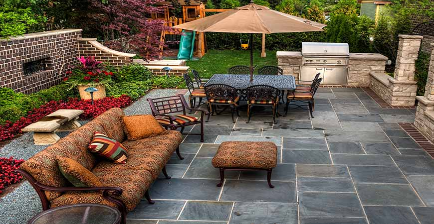 Wet & Forget easily cleans moss and algae off blue limestone pavers and outdoor furniture
