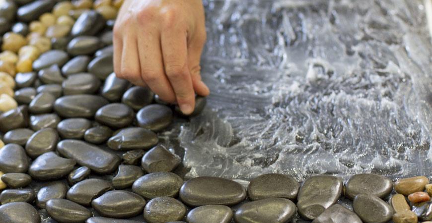 Creating a pebble bath mat