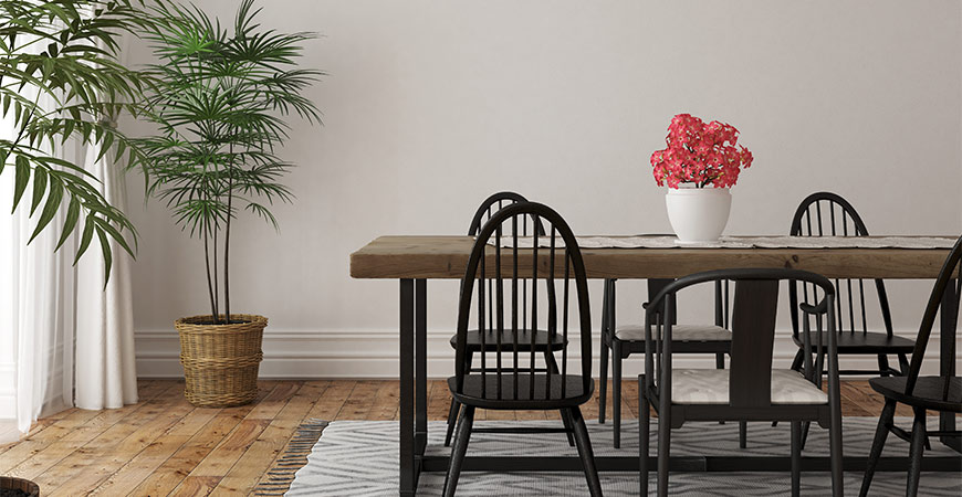 Place an area rug underneath a kitchen table and chairs.