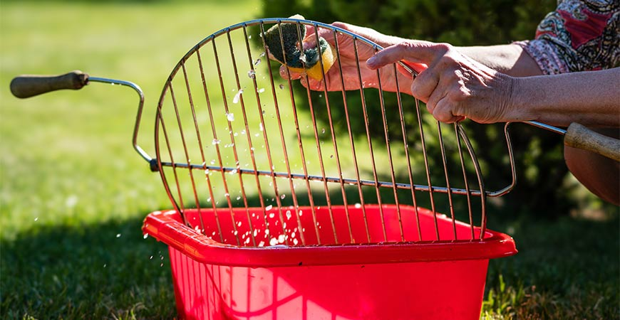 Clean the grill grate with warm soapy water.
